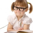 Happy little girl with book wearing black glasses — Stock Photo