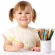 Cute child draws with color pencils — Stock Photo