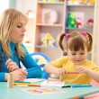 Teacher with child in preschool — Stock Photo #4149634