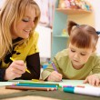 Teacher with child in preschool — Stock fotografie #4149710