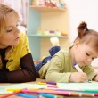 Teacher with child in preschool — Stock Photo #4149720