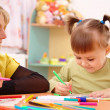 Stock Photo: Teacher with child in preschool