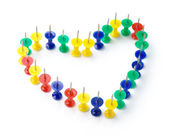 Heart shape made of color thumbtacks — Stock Photo
