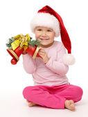 Little girl holds red Christmas bells — ストック写真