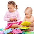 Stock Photo: Little boy and girl are playing with alphabet