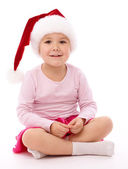 Little girl wearing red Christmas cap — Stock Photo