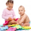 Little boy and girl are playing with alphabet — Stock Photo