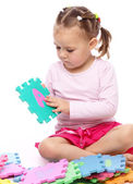 Little girl with alphabet — Stock Photo