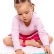 Little girl with alphabet — Stock Photo #4548430
