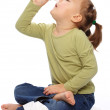 Little girl spraying her nose — Stock Photo #4548466