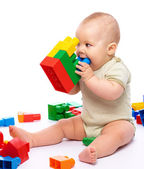 Little boy with building bricks — Stock Photo