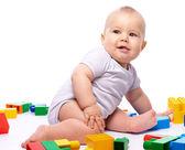 маленький мальчик с кирпич строительный — Стоковое фото