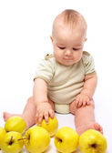 Little boy play with apples — Stock Photo