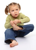 Little girl hurt her tiptoe — Stock Photo