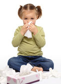 Little girl blows her nose — Stockfoto
