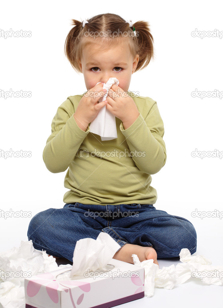 Little girl blows her nose while sitting on floor, isolated over white  Stock Photo #4548463