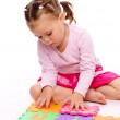 Little girl with alphabet — Stock Photo #4608966