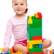 Little girl with building bricks — Stock Photo #4608982