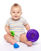 Little boy play with toys — Stock Photo