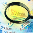 Euro currency under a magnifying glass — Stock Photo