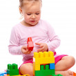 Little girl with building bricks — Stock Photo