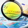 Royalty-Free Stock Photo: Euro currency under a magnifying glass
