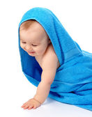 Cute child wrapped in blue towel — Stock Photo