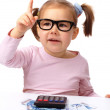 Little girl plays with money — Stock Photo