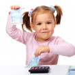 Stock Photo: Little girl with few paper euro banknotes