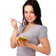 Young attractive woman eats vegetable salad — Stock Photo