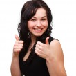 Young woman showing thumb up gesture — Stock Photo #5265970