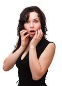 Young woman holding her face in astonishment — Stock Photo