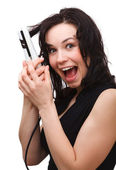 Woman is screaming while using hair straightener — Stock Photo