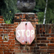 Stop sign on brick wall — Stock Photo
