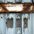 Letter flap on old wooden door — Stock Photo