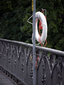 Lifebuoys on bridge — Stock Photo