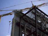 Facade and crane — Stock Photo
