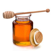 Honey jar and dripper — Stock Photo