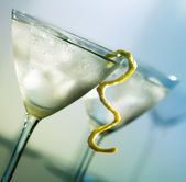 Martini with lemon peel — Stock Photo