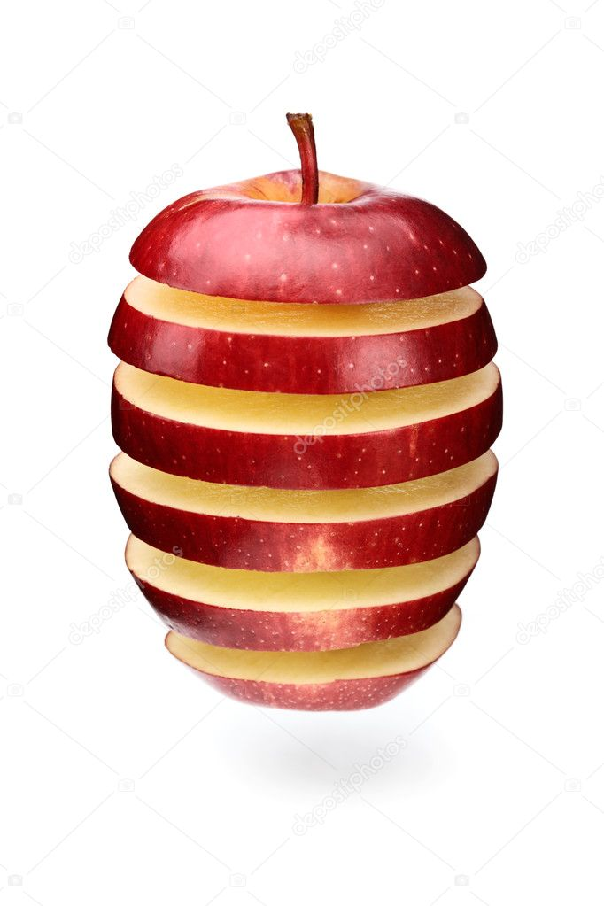 A red apple sliced in layers and arranged with gaps  Stockfoto #3972295