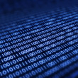 Binary code on pixellated screen - Stock Photo