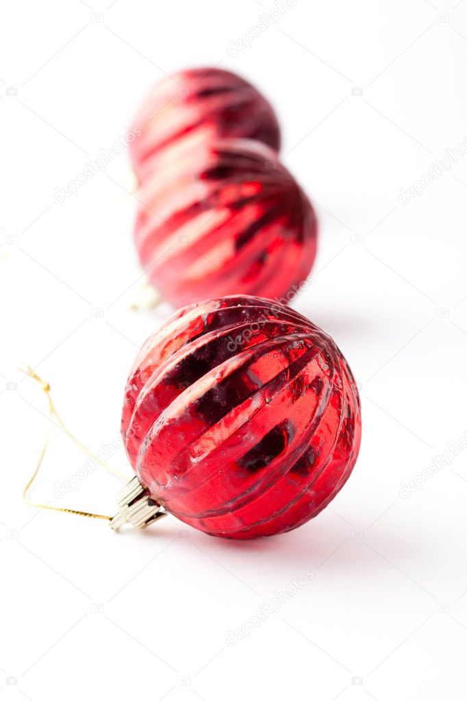 Red Christmas baubles on a white background — Stock Photo #4316033