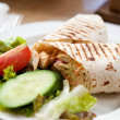 Stock Photo: Delicious chicken wrap