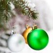 Christmas baubles on a snowy pine — Stock Photo #4779215