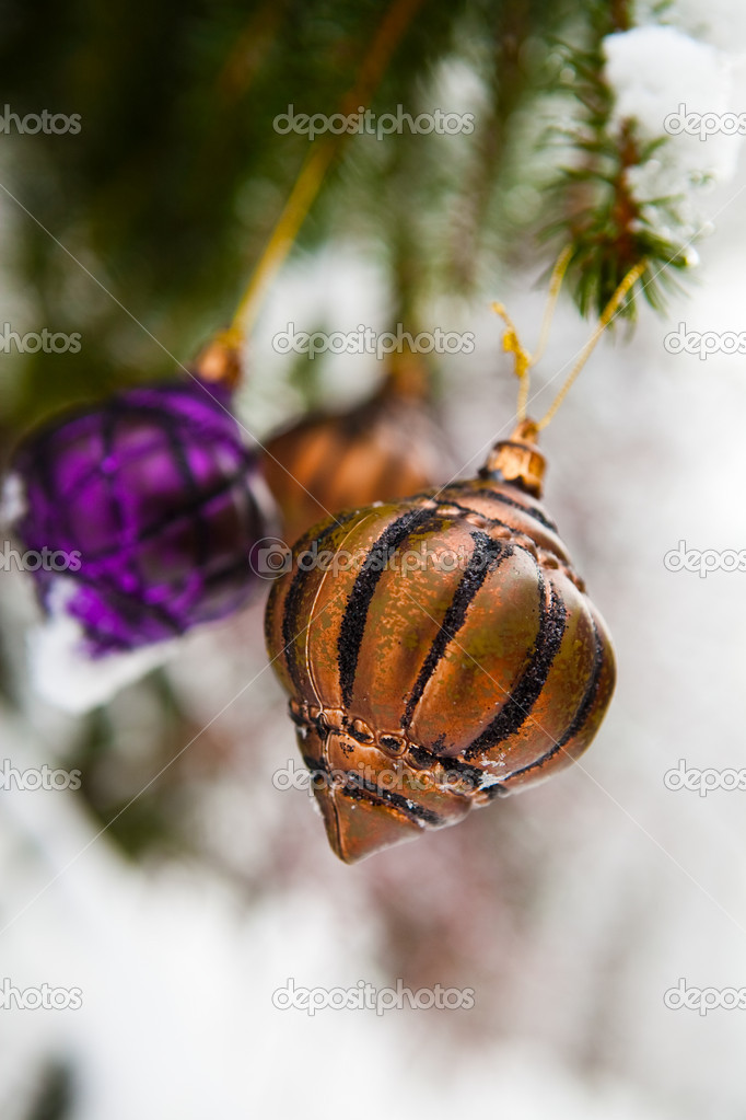 Christmas baubles on a snowy pine on a cold winter day  Stock Photo #4779194