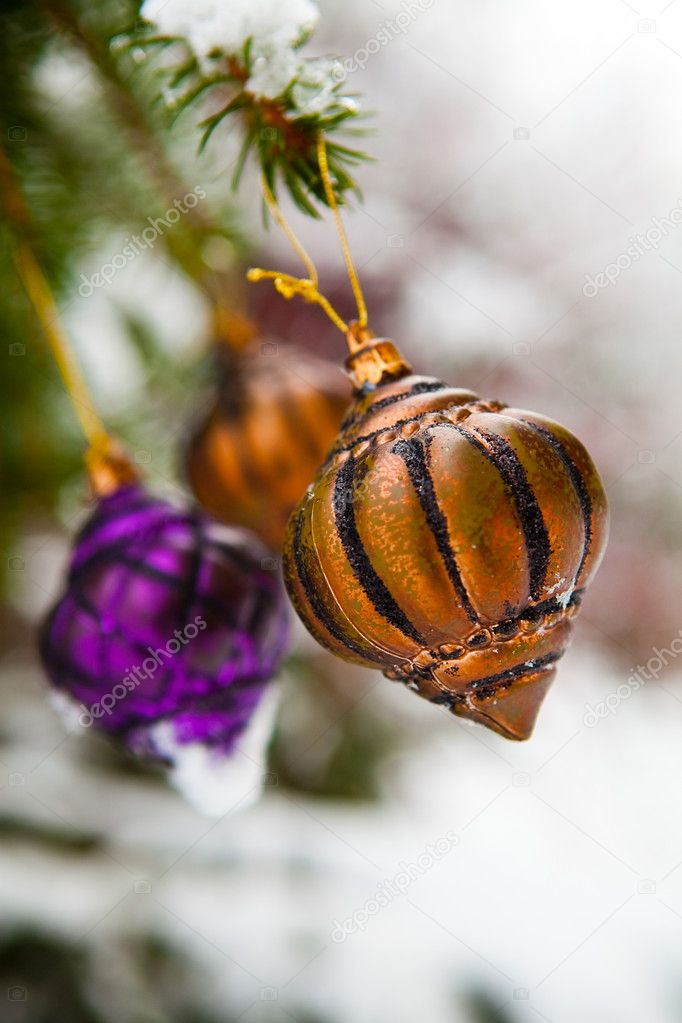 Christmas baubles on a snowy pine on a cold winter day  Stock Photo #4779205