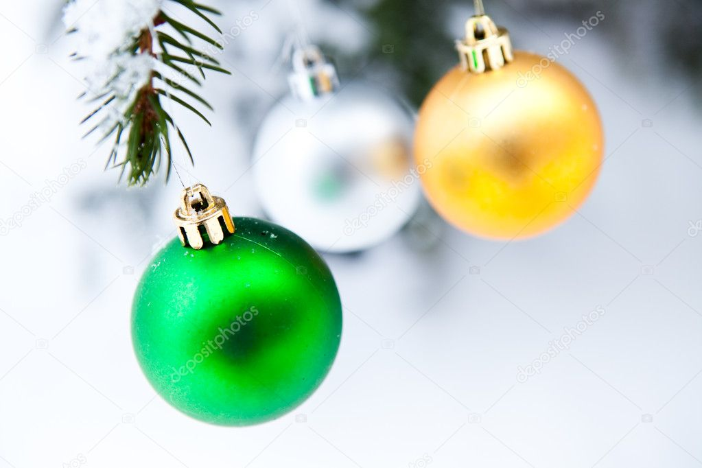 Christmas baubles on a snowy pine on a cold winter day — Stock Photo #4779209