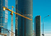 Lifting crane and buildings — Stock Photo