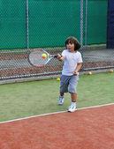 Young boy play tennis — Stock Photo