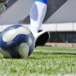 Stock Photo: Soccer player shooting ball